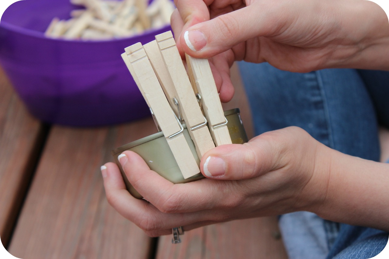 putting clothespins on