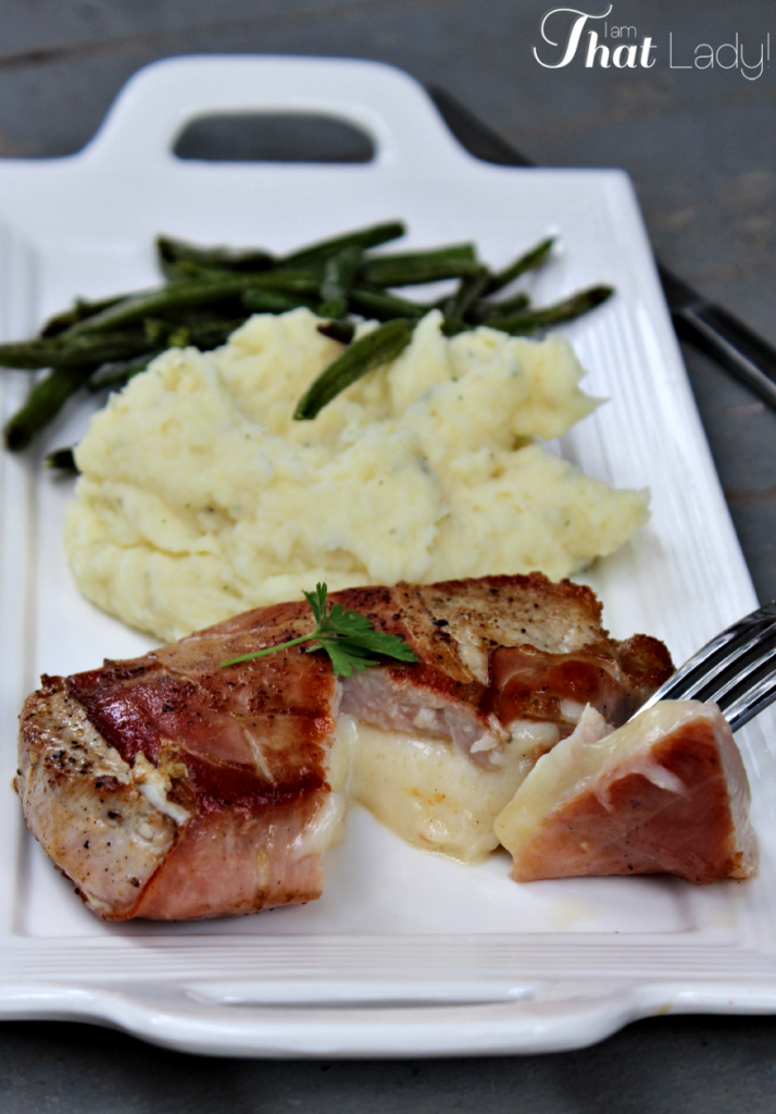 This AMAZING Prosciutto-wrapped Stuffed Pork Chop is sure to impress your guests! They will never know how EASY it was to prepare!