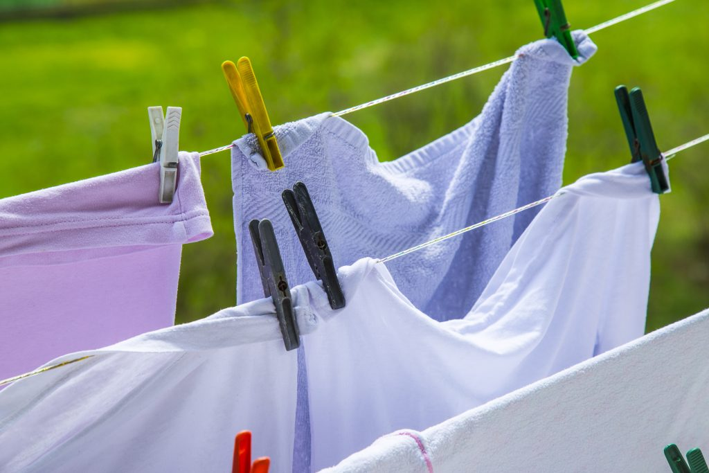 Clothes hanging to dry on a laundry line. Blurred background