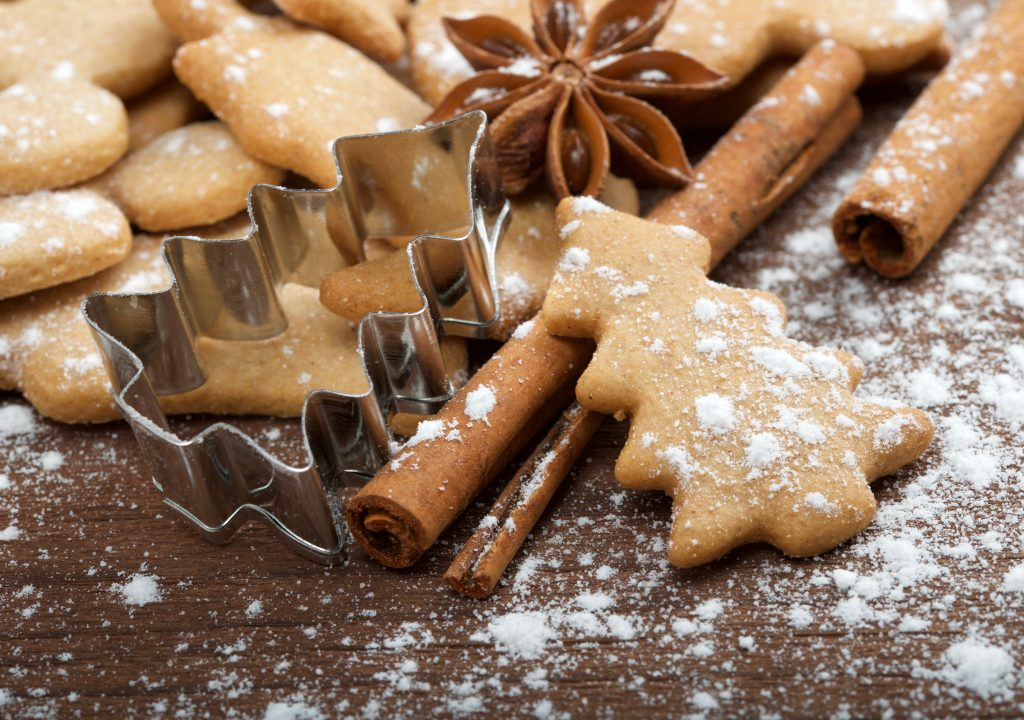 Christmas sweets on wooden background