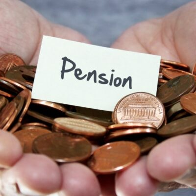 Man holding coins for pension plan
